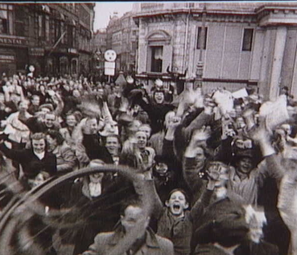 Enthusiastic crowd celebrates freedom fighters at Gammeltorv in Copenhagen on 5 May 1945. More images from The Museum of Danish Resistance: erez.natmus.dk/FHMbilleder/Site/index.jsp